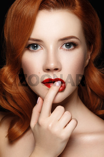 Portrait of young sexual redhead naked girl