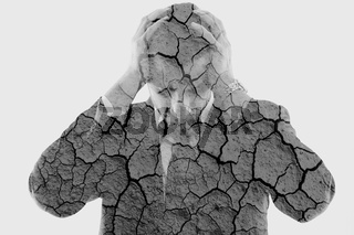 double exposure of depressed business man and dry ground background