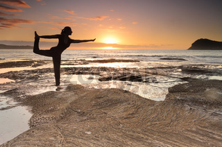 Yoga King Dancer Pose balance by the sea