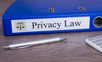 Privacy Law blue binder in the office