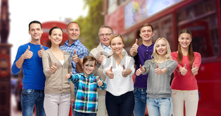group of people showing thumbs up over london city