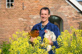 Farmer with chickens
