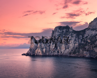 Beautiful summer sunset at the sea with mountains