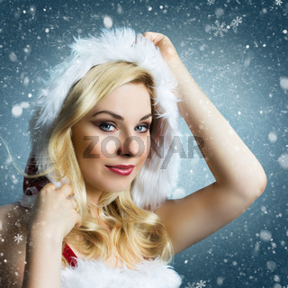 attractive smiling miss santa in the snow