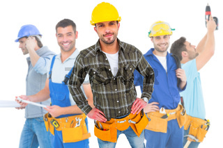 Composite image of handyman wearing tool belt with hands on hips