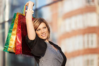 Happy young fashion woman with shopping bags