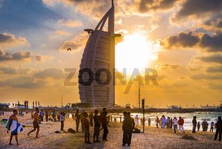Crowded beach of Jumeirah Marina on sunny day, Dubai.