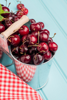 Cherries in two small metal buckets