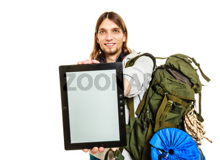 Backpacker with tablet. Blank screen copyspace.