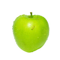 Green apple with caterpillar isolated on white.