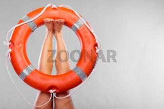 Life buoy ring on female legs
