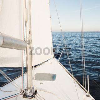 Yacht sailing towards the sunset