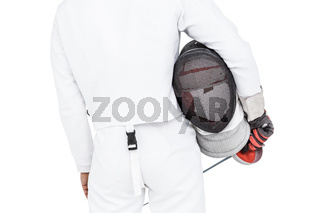 Rear view of swordsman holding fencing mask and sword