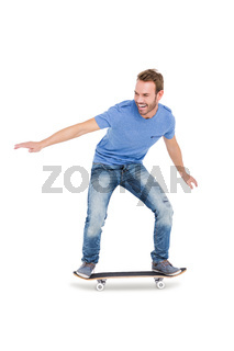 Happy young man skateboarding