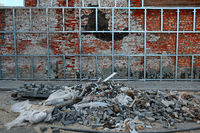 Repair of old brick wall. Mounting new surface on aluminium rails.