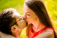 Couple kissing in nature