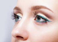 female eye zone and brows with evening green eyeliner makeup