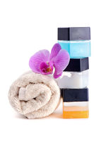 Stack of spa accessories with flower
