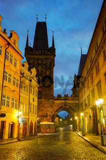 Old Prague street with Charles bridge