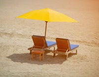 Two chairs on a tropical beach