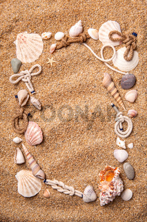 frame from various shells on sand