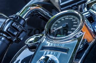 Motorcycle speedometer and handlebar.