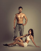 Young athletic man and woman