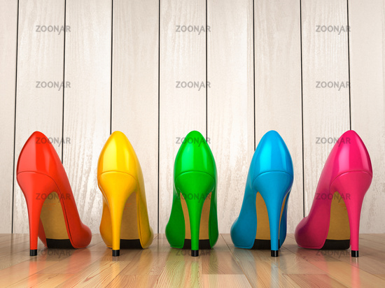 Shopping concept. Choice of colored high heels shoes on white wood background.