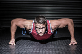 Portrait of muscular man doing push-ups