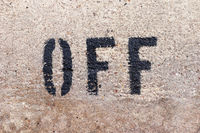 OFF letters on the marbel wall