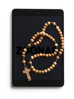 wooden rosary beads with computer tablet