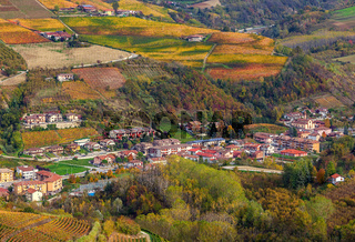 Small town among autumnal hills in Italy.