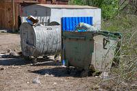 City trash cans in slum area