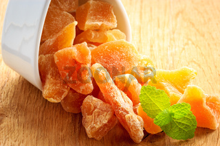 Closeup candied dried ginger in white bowl