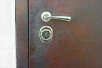 Metal door handle, the door is closed, rusty metal surface , copyspace