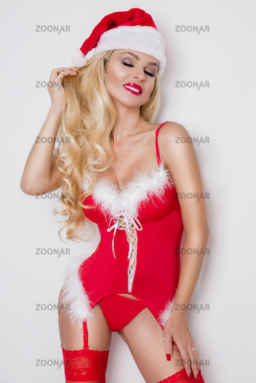 59c2bba5f32 Beautiful sexy blonde female model snowflake dressed as Santa Claus erotic  red lingerie with white fur and amazing stockings and high heels lovely  makeup ...