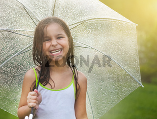 Little girl under umbrella in rainy day