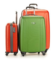 Luggage consisting of three polycarbonate suitcases isolated on white