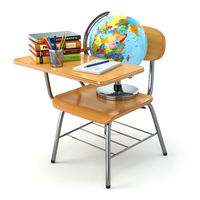Wooden school desk and chair with books, pencils and globe isolated on white.