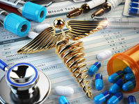 Healthcare medical concept. Pills, capsules, stethoscope, syringe and caduceus sign on the blood test results.