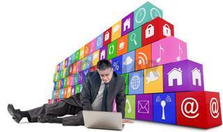 Composite image of mature businessman sitting using laptop