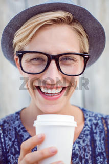 Pretty blonde woman holding goblet