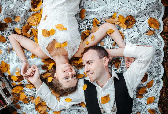 wedding couple lying under a tree