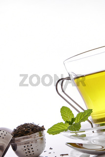 Cup of green tea with mint front view close up