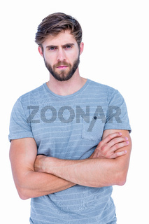 Unhappy handsome man looking at camera with arms crossed