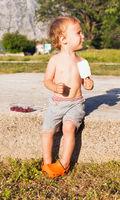 The little boy eats ice-cream