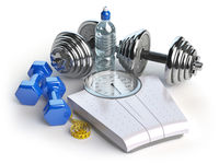 Fitness and weight loss concept. Weight scales, dumbbells and measuring tape. Healthy lifestyle.