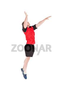 Sportsman hitting volleyball
