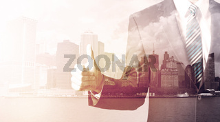 Businessman standing at cityscape background