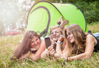 Group of best friends taking a picture on their camping holiday